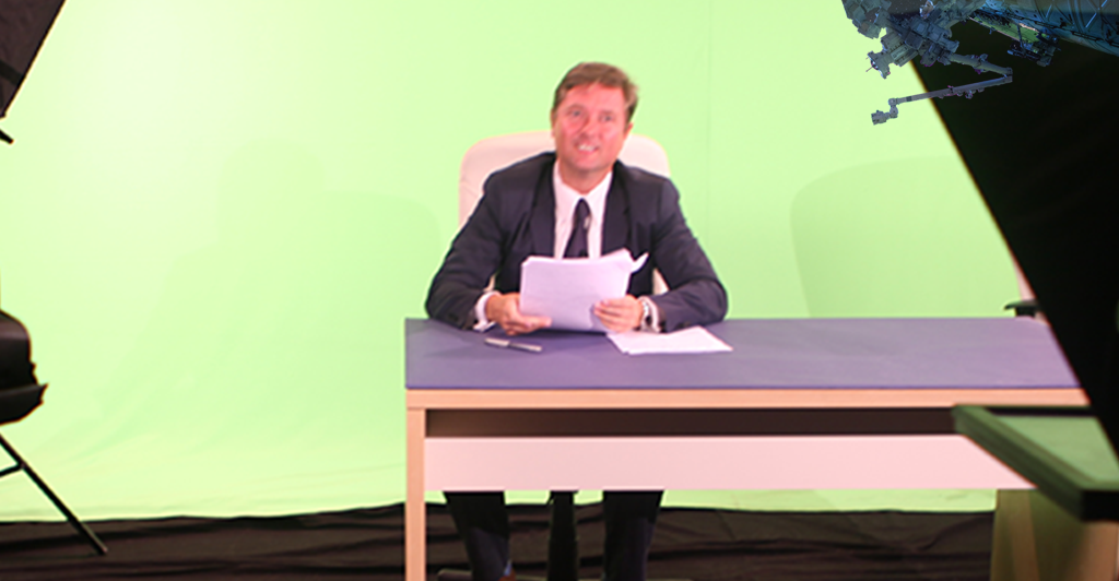 Steve Yanor of the social media agency Sky Alphabet in front of a green screen